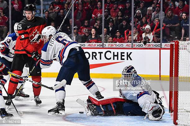 Casey Fitzgerald of Team United States defends against Nicolas Roy of Team Canada while goaltender Tyler Parsons of Team United States makes a save...