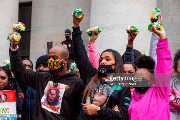 Casey Goodson Jr.'s family and attorney, Sean Walton , raise subway sandwiches during a protest for Casey Goodson Jr. In front of the Ohio Statehouse...