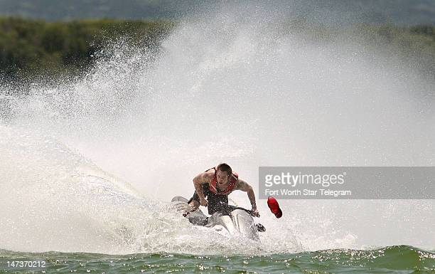 Casey Hall from Arlington kicks up big water and loses his cap while making a tight turn on his Wave Runner at Lynn Creek Park in far south Grand...