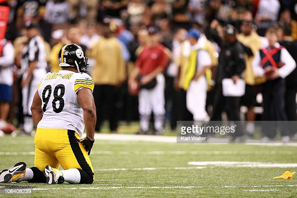 Casey Hampton of the Pittsburgh Steelers kneels after being flagged for a late hit during the game against the New Orleans Saints at Louisiana...