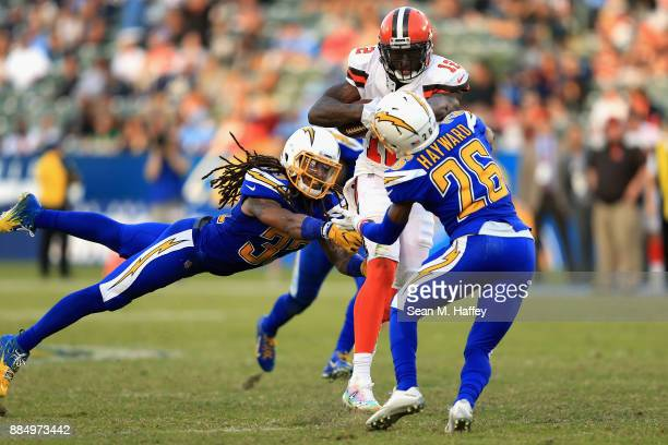 Casey Hayward and Tre Boston of the Los Angeles Chargers tackle Josh Gordon of the Cleveland Browns on a run play during the second half of a game at...