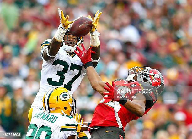 Casey Hayward defends as Sam Shields of the Green Bay Packers fails to intercept this pass intended for Russell Shepard of the Tampa Bay Buccaneers...