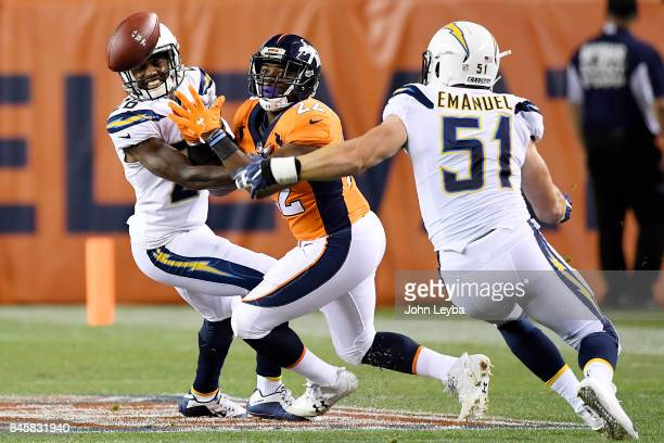 Casey Hayward of the Los Angeles Chargers and Kyle Emanuel defend CJ Anderson of the Denver Broncos during the first quarter on Monday September 11...