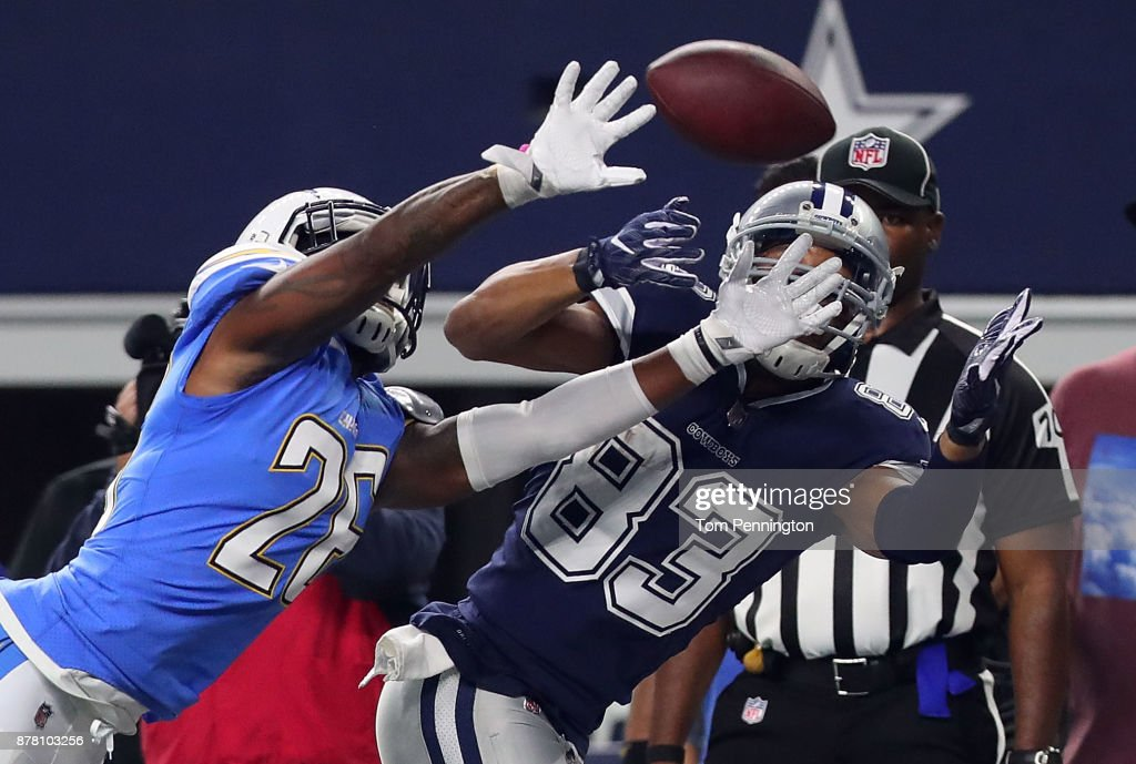 Casey Hayward #26 of the Los Angeles Chargers tries to break up a pass intended for Terrance Williams #83 of the Dallas Cowboys in the second half of a football game at AT&T Stadium on November 23, 2017 in Arlington, Texas.