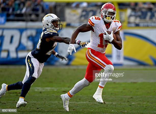 Casey Hayward of the San Diego Chargers runs after Jeremy Maclin of the Kansas City Chiefs en route to the Chargers 3727 loss to the Chiefs during...
