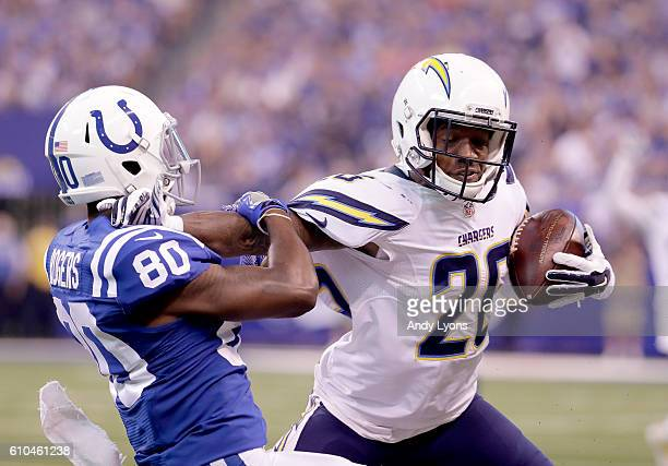 Casey Hayward of the San Diego Chargers stiff arms Chester Rogers of the Indianapolis Colts after picking off a pass during the game against the...