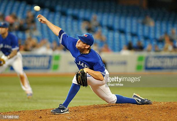 Casey Janssen of the Toronto Blue Jays delivers a pitch during MLB game action against the Los Angeles Angels of Anaheim June 28 2012 at Rogers...