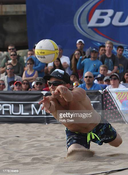 Casey Jennings digs the ball during the men's finals at the AVP Manhattan Beach Open on August 25 2013 in Manhattan Beach California Jennings and his...