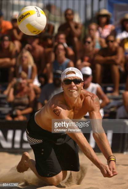Casey Jennings dives for a dig during the AVP 2005 Nissan Series Manhattan Beach Open match against Eric Fonoimoana and Albert Hannemann at South...