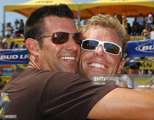 Casey Jennings is embraced by announcer Chris McGee during the AVP Hermosa Beach Open men's final in Hermosa Beach Calif on Saturday July 23 2005...