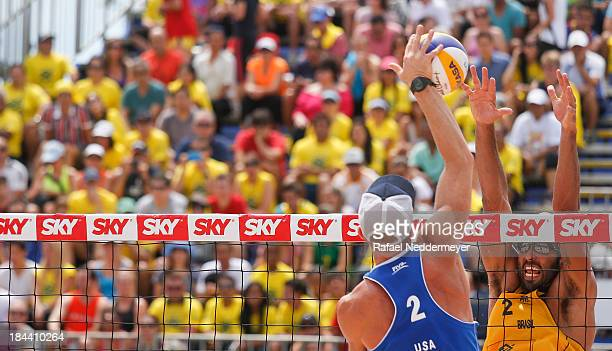 Casey Jennings of United States and Pedro Salgado of Brazil in action during day six of the FIVB Beach Volleyball Sao Paulo Grand Slam 2013 at Parque...