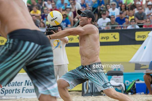 Casey Jennings sets the ball for Bill Kolinske at the AVP New Orleans Open at Laketown on May 23 2015 in Kenner Louisiana