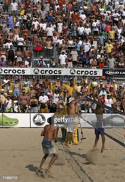 Casey Jennings spikes against Sean Scott during the AVP Seaside Heights Open on July 2 2006 in Seaside Heights New Jersey