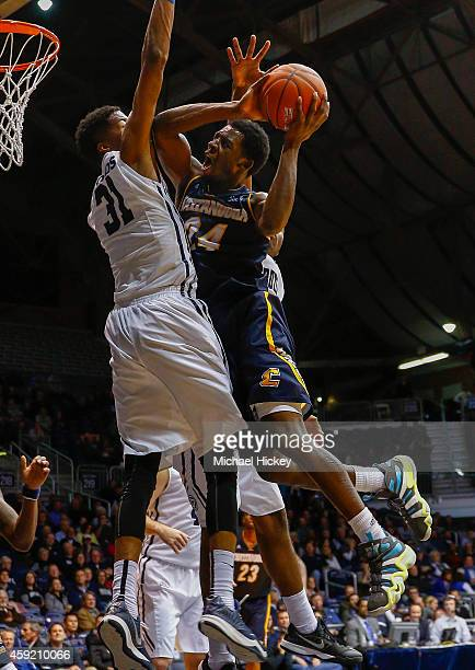 Casey Jones of the Chattanooga Mocs shoots the ball against Kameron Woods of the Butler Bulldogs at Hinkle Fieldhouse on November 18 2014 in...
