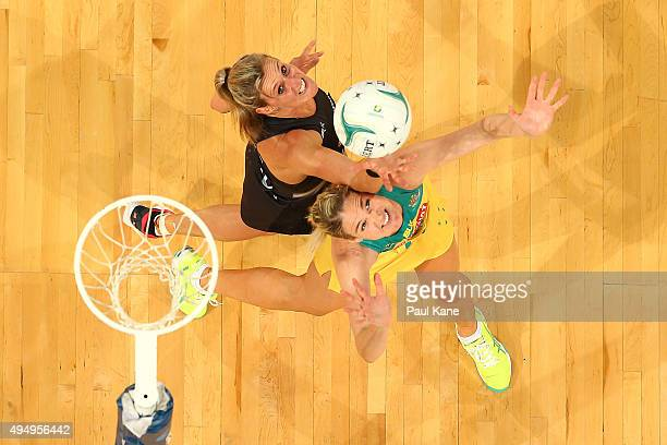 Casey Kopua of New Zealand and Caitlin Bassett of Australia contest for the ball during the International Test Match between the Australian Diamonds...