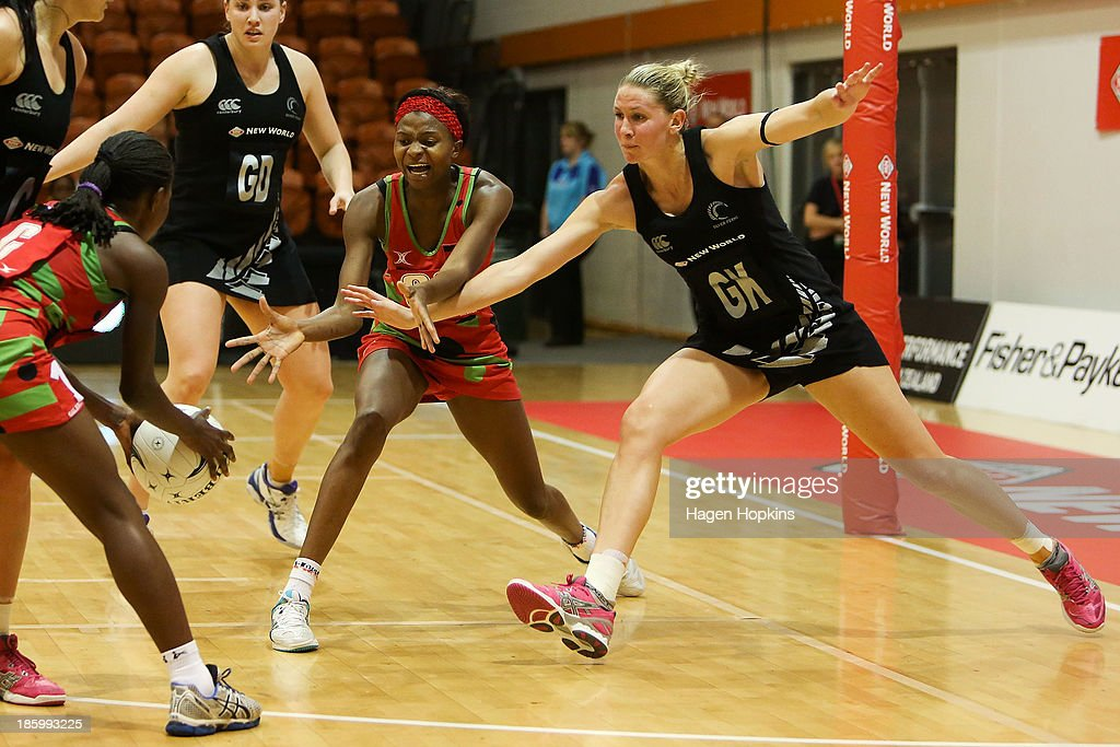 Casey Kopua of New Zealand defends against Takondwa Lwazi and Jessie Mazengera of Malawi during the International Test Match between the New Zealand Silver Ferns and the Malawai Queens at Pettigrew Green Arena on October 27, 2013 in Napier, New Zealand.