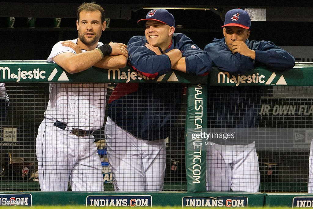 Casey Kotchman #35 Justin Masterson #63 and Michael Brantley #23 of the Cleveland Indians watch the game from the dugout during the seventh inning against the Chicago White Sox at Progressive Field on October 3, 2012 in Cleveland, Ohio.