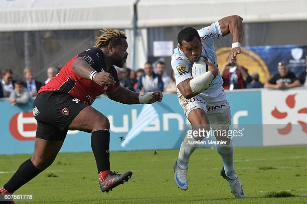 Casey Laulala of Racing Metro 92 is being tackled by Mathieu Bastareaud of Racing Club de Toulon during the Top 14 match between Racing Metro 92 and...