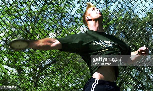 Casey Malone CSU discus thrower at the moment of release of the 22 kg disc he throws He is a fifth year senior in liberal arts study at CSU This at...