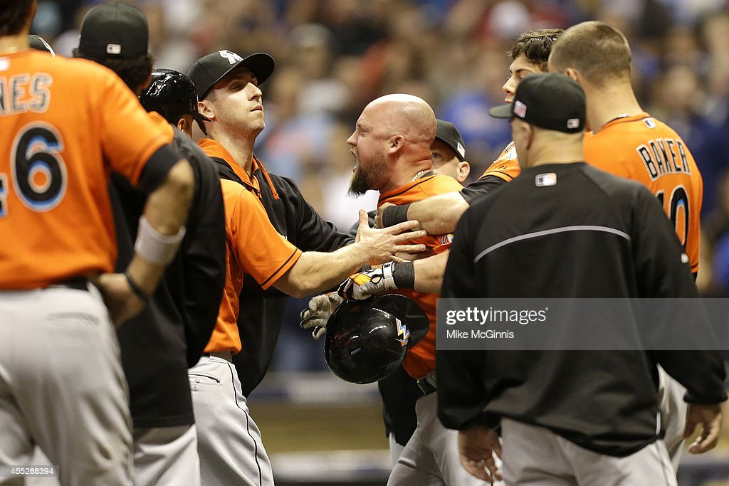 Casey McGehee #9 of the Miami Marlins yells at Mike Fiers of the Milwaukee Brewers at Miller Park on September 11, 2014 in Milwaukee, Wisconsin.