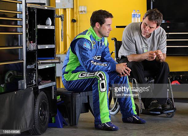 Casey Mears driver of the Ford talks with crew chief Robert Barker during the NASCAR Sprint Cup Preseason Thunder testing at Daytona International...