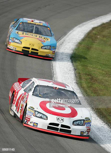 Casey Mears driver of the Ganassi Racing Target Dodge is followed by Jeff Green driving the Cheerios/Betty Crocker Dodge during practice for the...