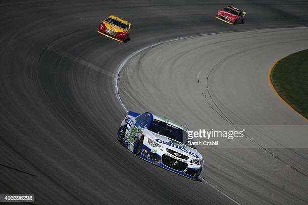 Casey Mears driver of the GEICO Chevrolet leads a pack of cars during the NASCAR Sprint Cup Series myAFibRiskcom 400 at Chicagoland Speedway on...