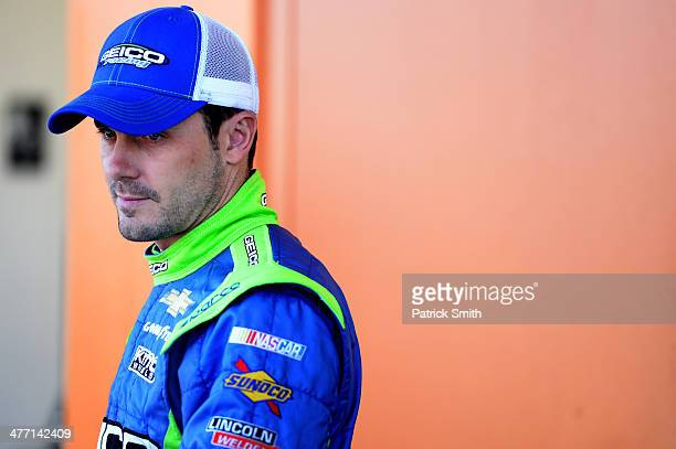 Casey Mears driver of the GEICO Chevrolet stands in the garage area during practice for the NASCAR Sprint Cup Series Kobalt 400 at Las Vegas Motor...