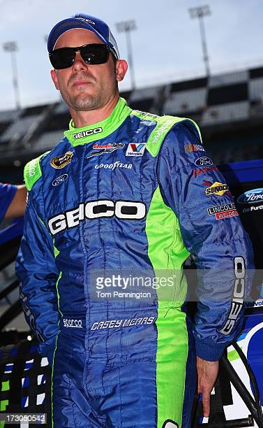 Casey Mears driver of the GEICO Ford looks on during qualifying for the NASCAR Sprint Cup Series Coke Zero 400 at Daytona International Speedway on...