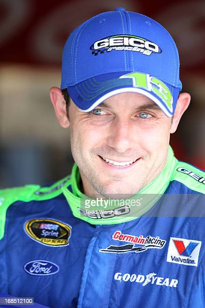 Casey Mears driver of the GEICO Ford stands in the garage area during practice for the NASCAR Sprint Cup Series Bojangles' Southern 500 at Darlington...