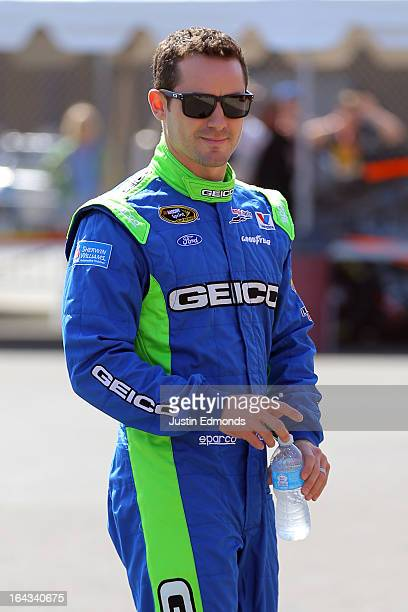Casey Mears driver of the GEICO Ford walks through the garage during practice for the NASCAR Sprint Cup Series Auto Club 400 at Auto Club Speedway on...