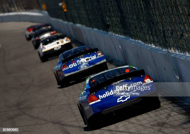 Casey Mears driver of the Holiday Inn/Holiday Inn Express Chevrolet drives behind a group of cars during the NASCAR Nationwide Series O'Reilly...