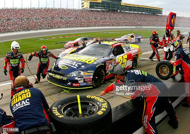 Casey Mears, driver of the National Guard/GMAC Chevrolet, makes a pit stop during the NASCAR Nextel Cup Series LifeLock 400 at Kansas Speedway on...