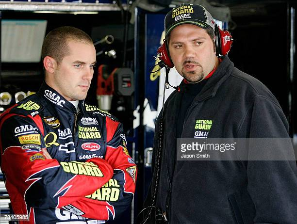 Casey Mears driver of the National Guard/GMAC Chevrolet talks with crew chief Darian Grubb during practice for the NASCAR Nextel Cup Series Auto Club...