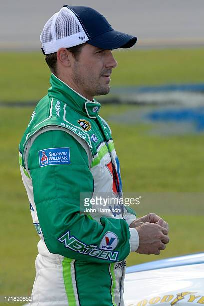 Casey Mears driver of the Valvoline NextGen Ford stands on the grid during qualifying for the NASCAR Sprint Cup Series Quaker State 400 at Kentucky...