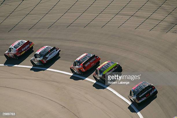 Casey Mears driving his Target Chip Ganassi Racing Dodge leads a pack of cars during the NASCAR Winston Cup Banquet 400 at the Kansas Speedway on...