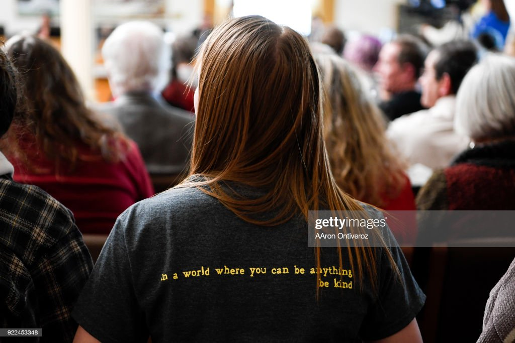 Casey Milliman wears a shirt reading 'In a world where you can be anything, be kind' as she and others fill the seats in the room where House Minority Leader Patrick Neville, R-Castle Rock, spoke to the Democratic-controlled House State, Veterans and Military Affairs Committee at the Colorado State Capitol on Wednesday, February 21, 2018. The committee heard three Republican bills to loosen Colorado gun laws. All are expected to be rejected by Democrats.