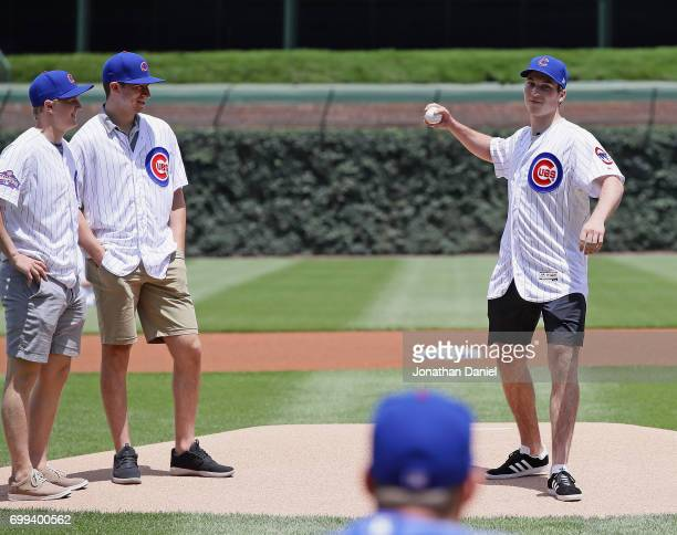 Casey Mittelstadt and Gabriel Vilardi watch as Nolan Patrick throws a ceremonial first pitch before the Chiucago Cubs take on the San Diego Padres...