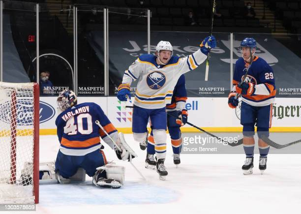 Casey Mittelstadt of the Buffalo Sabres celebrates a goal by Curtis Lazar at 17:15 of the first period against Semyon Varlamov of the New York...