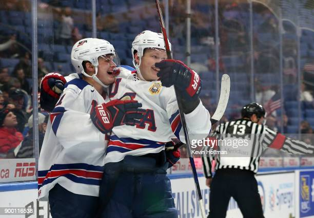 Casey Mittelstadt of United States celebrates his goal against Finland with Brady Tkachuk in the first period during the IIHF World Junior...