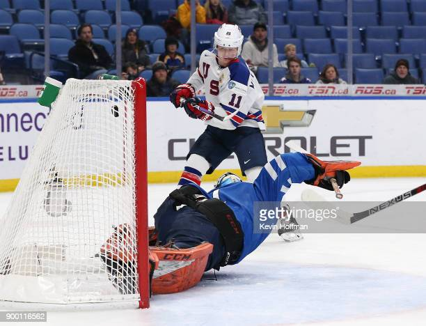 Casey Mittelstadt of United States scores a goal on UkkoPekka Luukkonen of Finland in the first period during the IIHF World Junior Championship at...