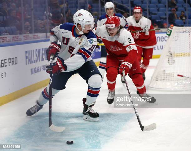 Casey Mittelstadt of United States skates with the puck as Oliver Larsen of Denmark defends in the second period during the IIHF World Junior...