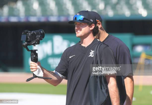 Casey Mize of the Detroit Tigers holds a camera while walking during the Detroit Tigers Summer Workouts at Comerica Park on July 3, 2020 in Detroit,...