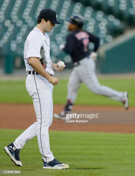 Casey Mize of the Detroit Tigers walks around the mound after giving up a solo home run to Jose Ramirez of the Cleveland Indians, right, during the...