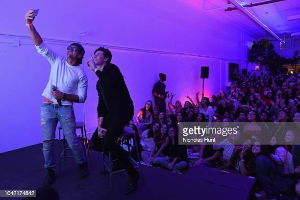Casey Neistat and Shawn Mendes take a selfie on stage during a special screening presented by YouTube Music of Shawn Mendes YouTube Artist Spotlight...
