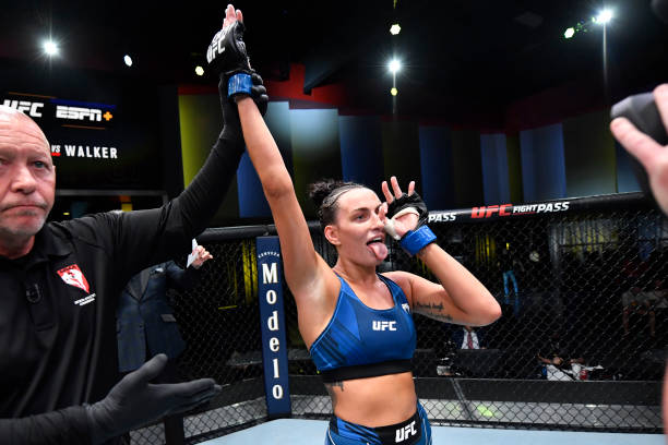Casey O'Neill of Australia celebrates her TKO victory over Antonina Shevchenko of Kyrgyzstan in their women's flyweight bout during the UFC Fight...
