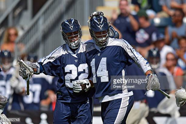 Casey Powell and Drew Westervelt of the Chesapeake Bayhawks celebrate a goal against the Charlotte Hounds during the MLL Championship at PPL Park on...