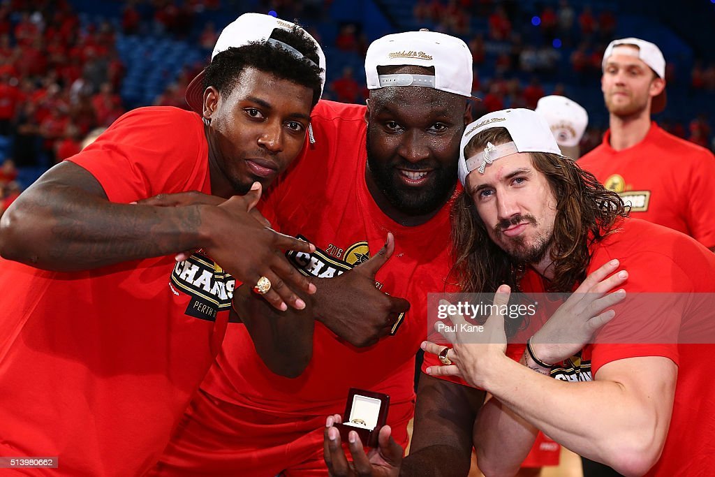 Casey Prather, Nate Jawai and Greg Hire of the Wildcats poase with their rings after winning the Championship during game three of the NBL Grand Final series between the Perth Wildcats and the New Zealand Breakers at Perth Arena on March 6, 2016 in Perth, Australia.