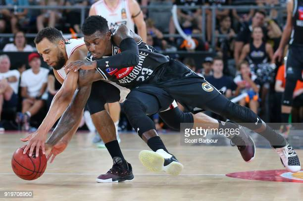 Casey Prather of Melbourne United and Demitrius Conger of the Hawks compete for the ball during the round 19 NBL match between Melbourne United and...