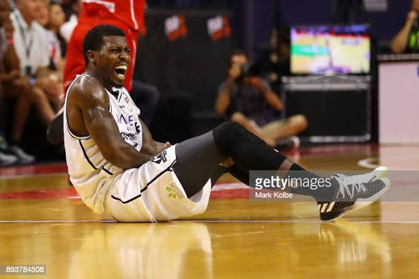 Casey Prather of Melbourne United holds his injured arm after falling during the round 10 NBL match between the Illawarra Hawks and the Melbourne...